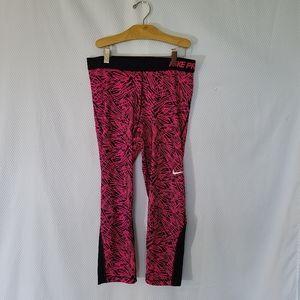 Nike dri fit capri leggings in fuschia and black